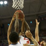 Casey Prather (24) steals the rebound in the second half of Saturday's game.