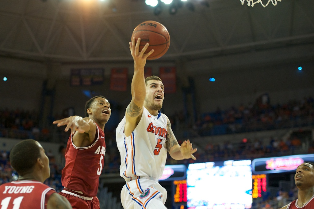 Scottie Wilbekin (5) goes for a lay up in the second half of Saturday's game against Arkansas.