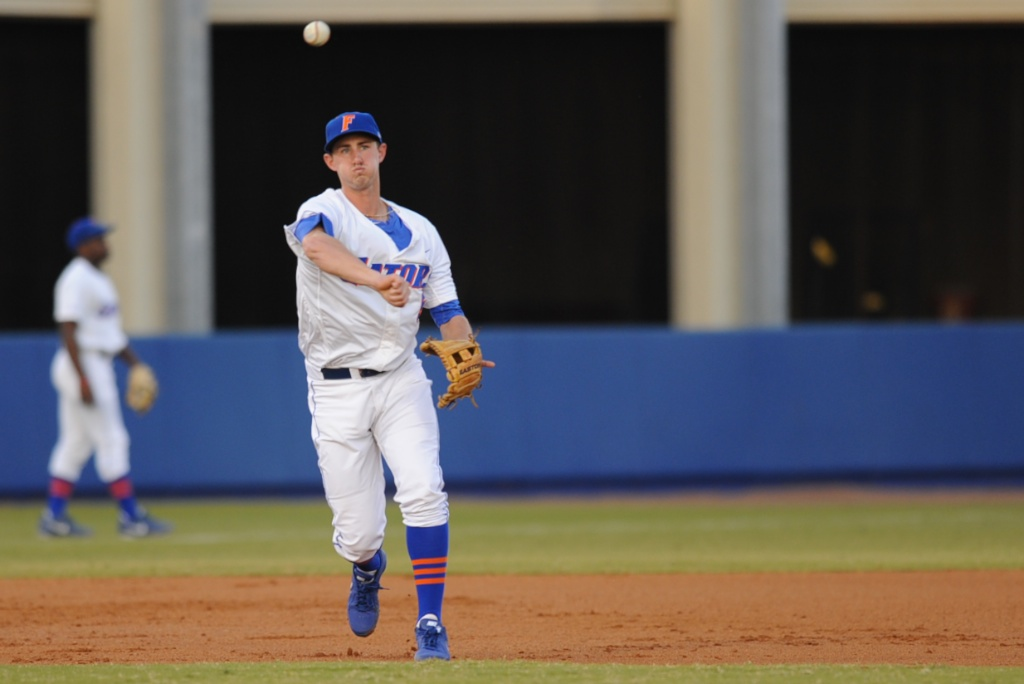 Zack Powers (5) throws the ball to first base for an out Friday night. The Gators lost to Ole Miss 4-3 Friday night in an 11-inning game at McKeethan Stadium.