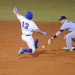 Connor Mitchell (13) safely slides into second base during Friday night's game. The Gators lost to Ole Miss 4-3 Friday night in an 11-inning game at McKeethan Stadium.