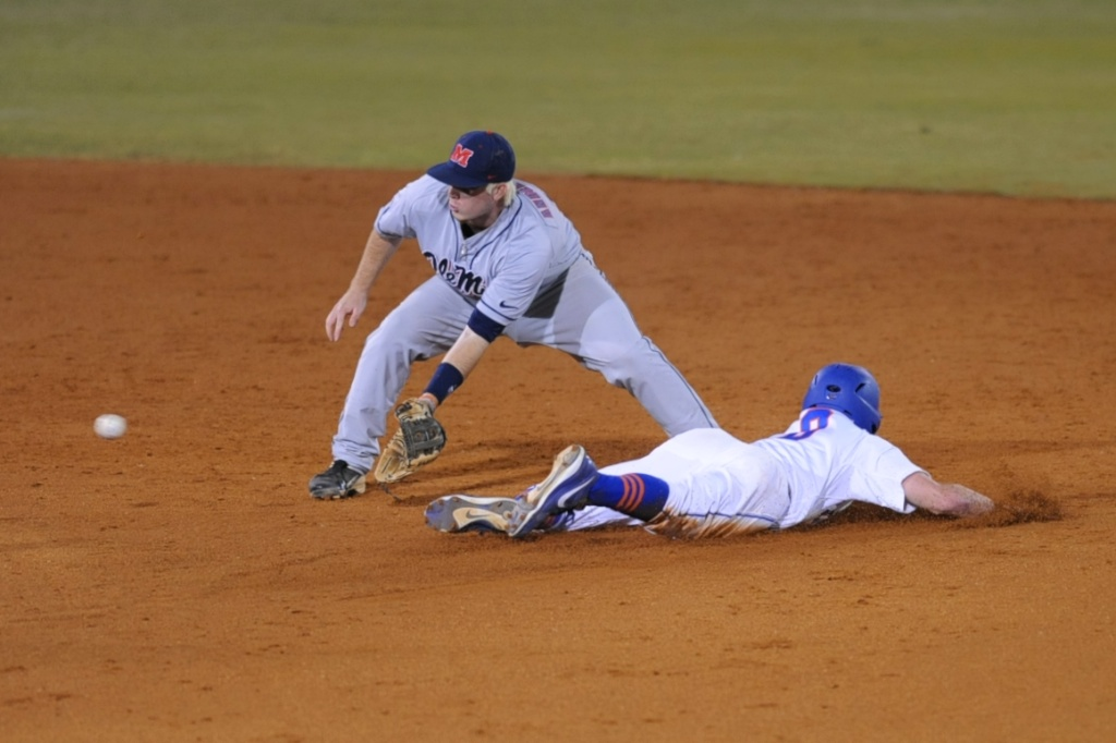 Harrison Bader (8) dives safely back to first base Friday night. The Gators lost to Ole Miss 4-3 Friday night in an 11-inning game at McKeethan Stadium.