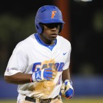 Josh Tobias (11) comes off the field after an argued call of being tagged out at second base. The Gators lost to Ole Miss 4-3 Friday night in an 11-inning game at McKeethan Stadium.