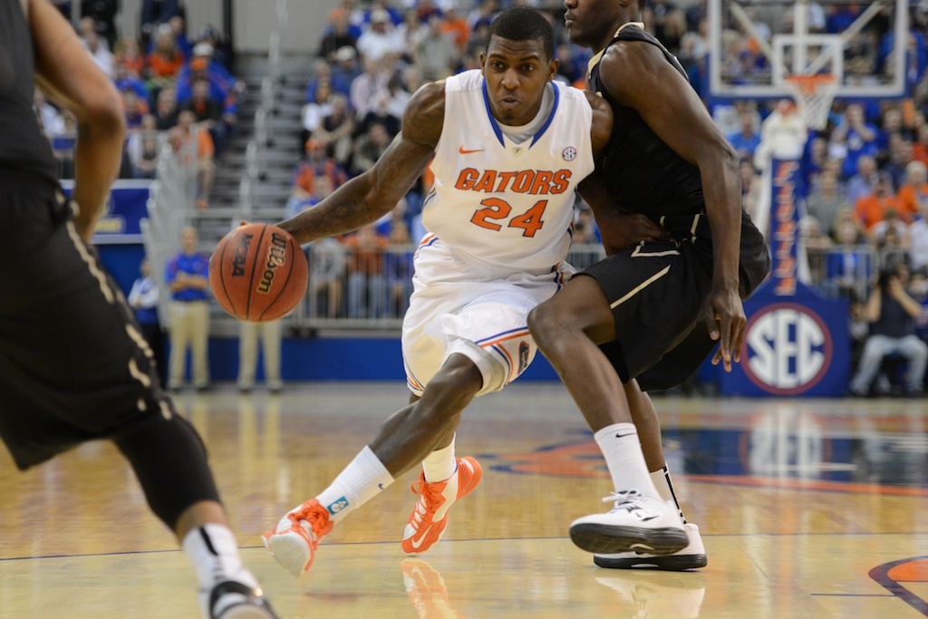 Casey Prather (24) passes Commodor defender in the second half of Wednesday night's game.