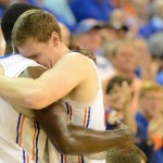 Senior Erik Murphy (33) and junior Patric Young (4) hug after Murphy walks off the O'Dome court for the last time as a member of the Florida Men's Basketball team.