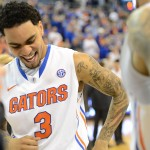 Mike Rosario (3) celebrates after Florida takes the SEC title Wednesday night.
