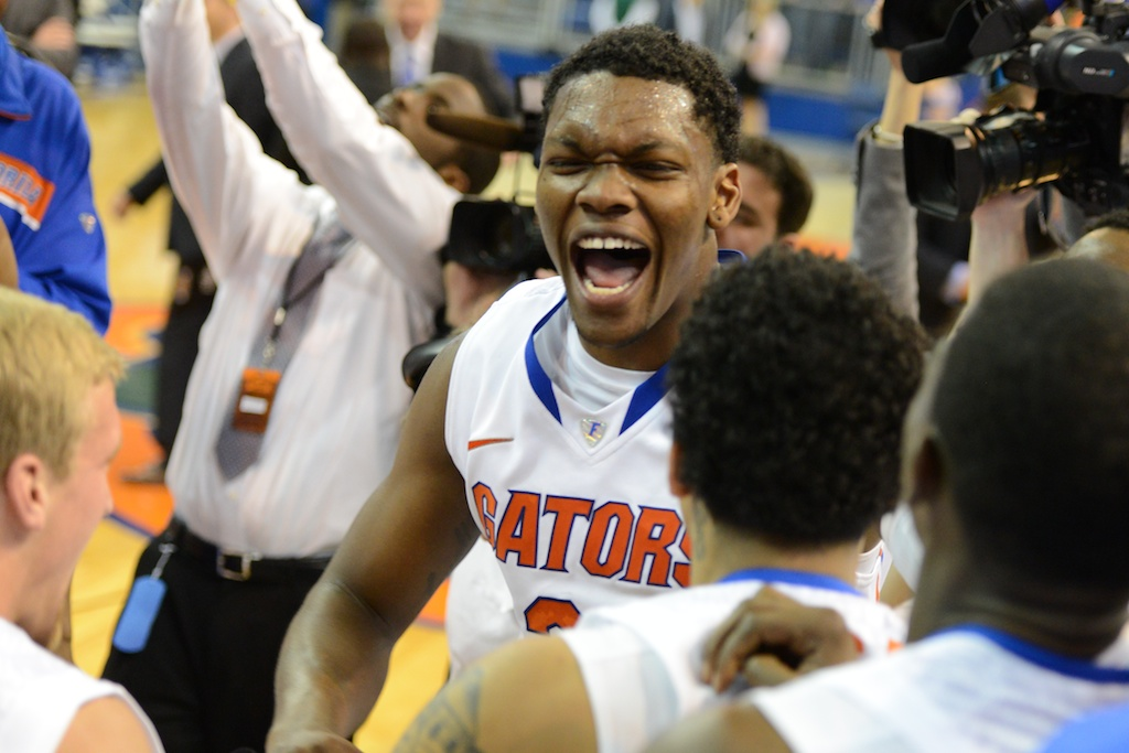 Michael Frazier (20) celebrates after the Gators take the SEC title Wednesday night.