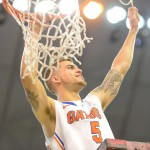Scottie Wilbekin (5) cuts a piece of the net Wednesday night after the Gators won the SEC title.