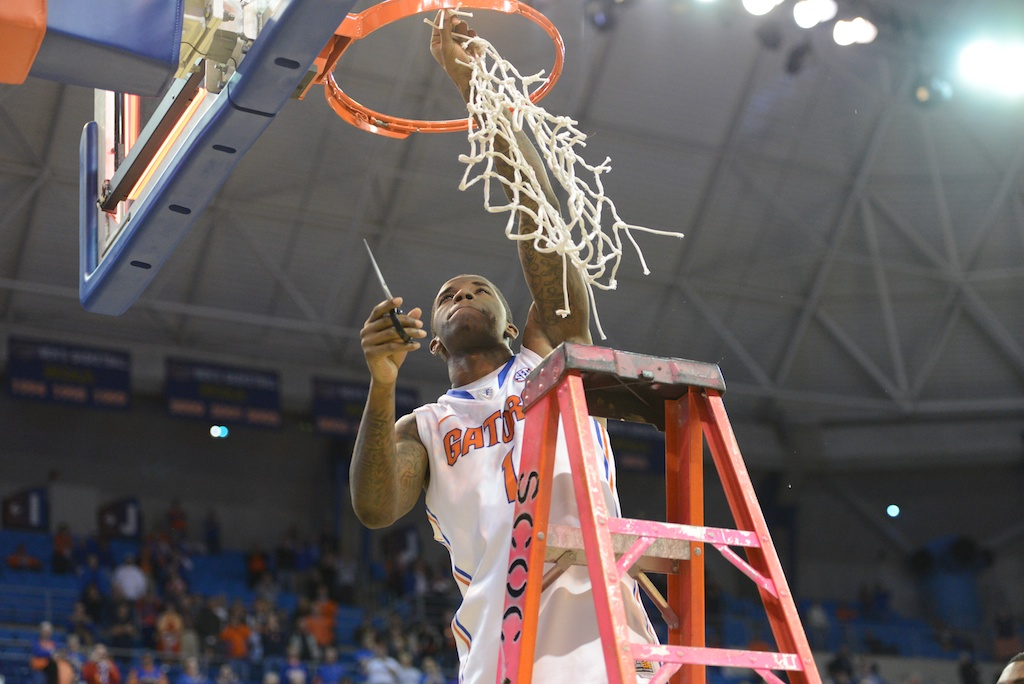Senior Kenny Boynton makes the final cut to a net Wednesday night after the Gators won the SEC title.