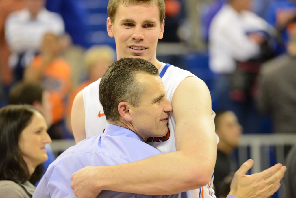 Erik Murphy and head coach Billy Donovan hug after the win Wednesday night.