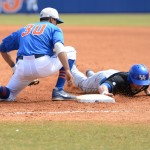 Kentucky player slides safely back into first base Sunday afternoon.