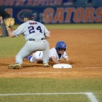 Casey Turgeon (2) dives safely back to first base Friday night. The Gators lost to Ole Miss 4-3 Friday night in an 11-inning game at McKeethan Stadium.