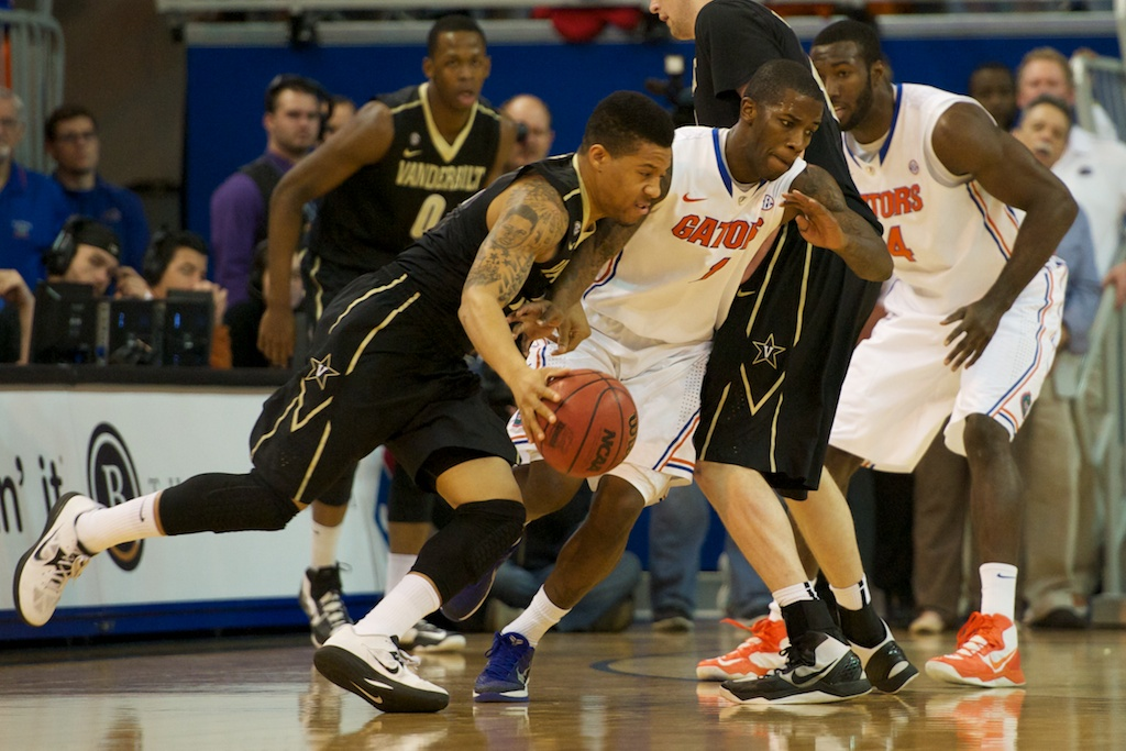 Senior Kenny Boynton (1) plays defense against the Vanderbilt Commodores in the first half of Wednesday's game.