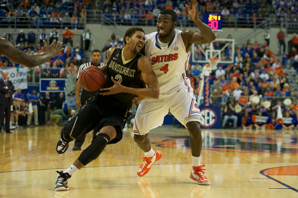 Patric Young (4) defends Kedren Johnson (2) of the Commodores Wednesday night.