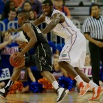 Patric Young (4) plays defense Wednesday night against the Vanderbilt Commodores.