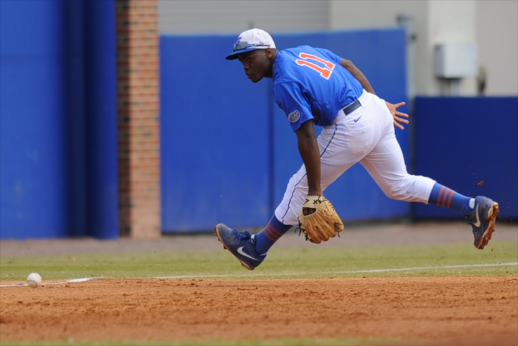 Josh Tobias (11) goes after the ball in Sunday's game against the Kentucky Wildcats.