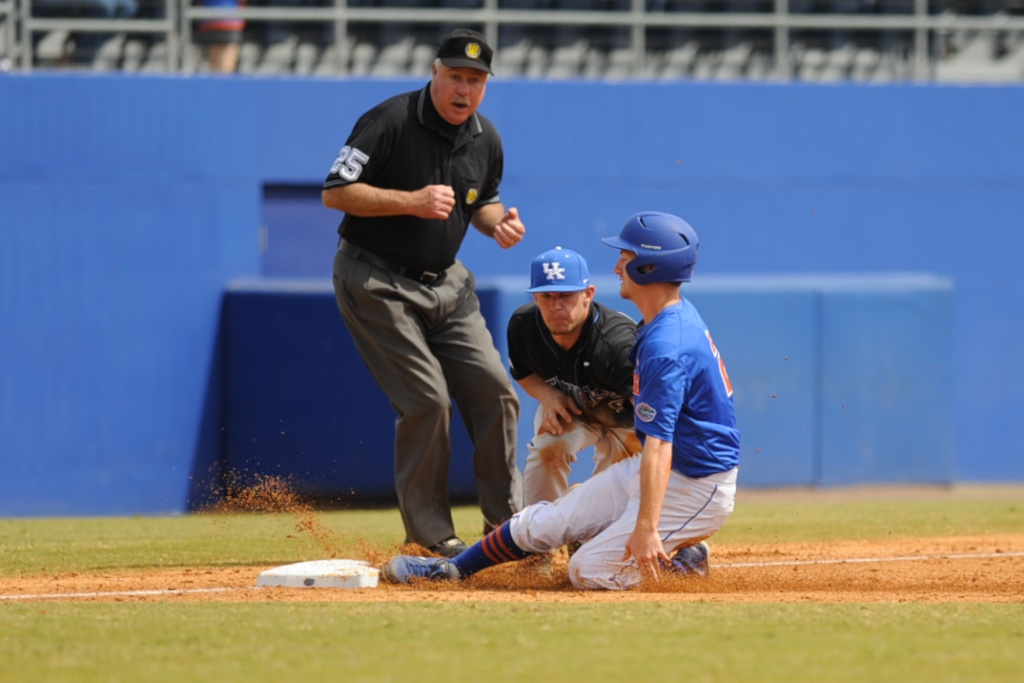 Casey Turgeon (2) slides into third base to be called out in Sunday's game against the Kentucky Wildcats.