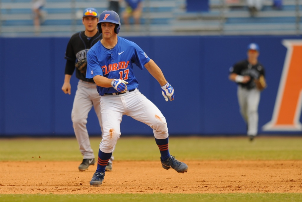 Taylor Gushue (17) shuffles between second and third base in an attempt to avoid an out for the Gators Sunday.