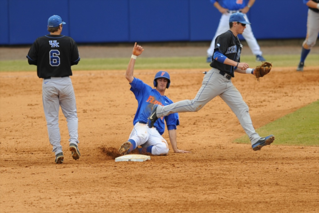 Zack Powers (5) slides into second in an attempt to avoid the out for the Florida Gators Sunday afternoon.