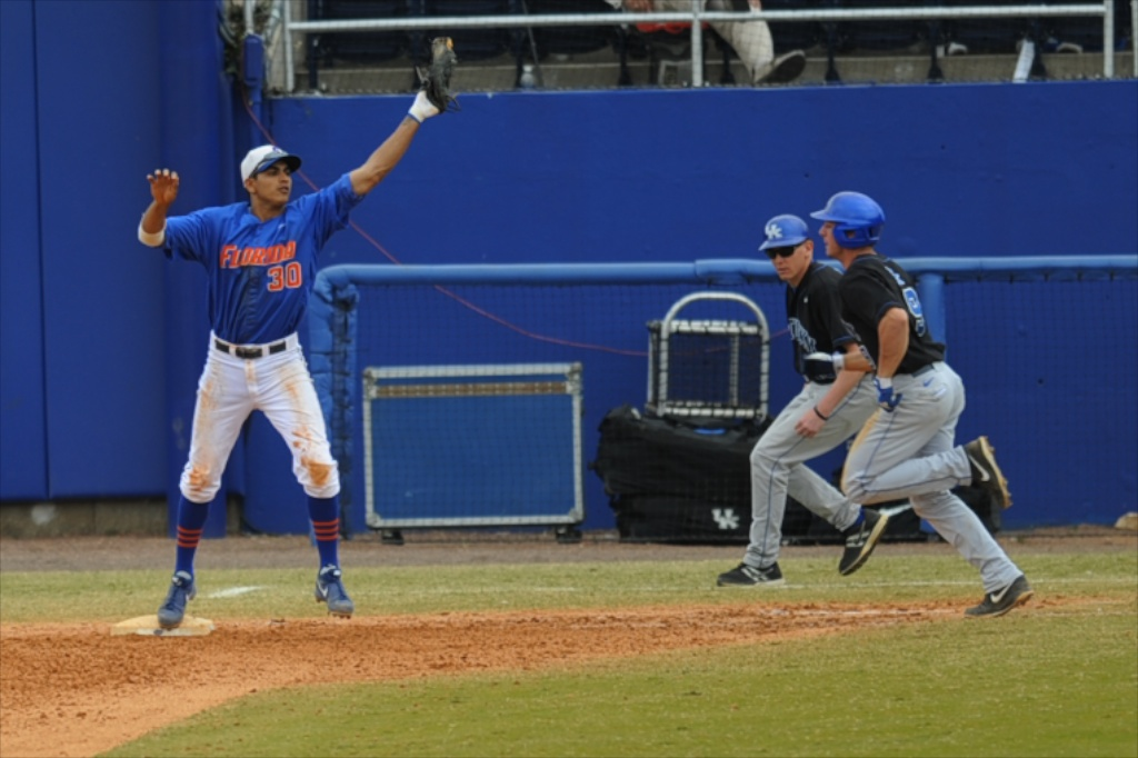 Vackash Ramjit (30) gets an out for the Florida Gators in Sunday's game against the Kentucky Wildcats.
