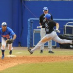 Vickash Ramjit (30) gets an out for the Florida Gators in Sunday's game against the Kentucky Wildcats.