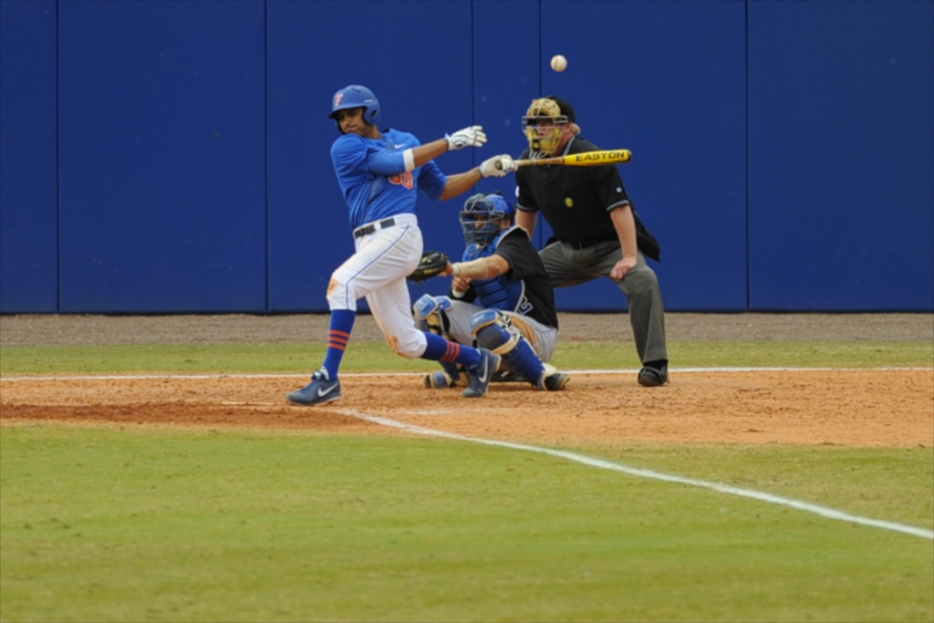 Vickash Ramjit (30) gets a hit for the Florida Gators Sunday.
