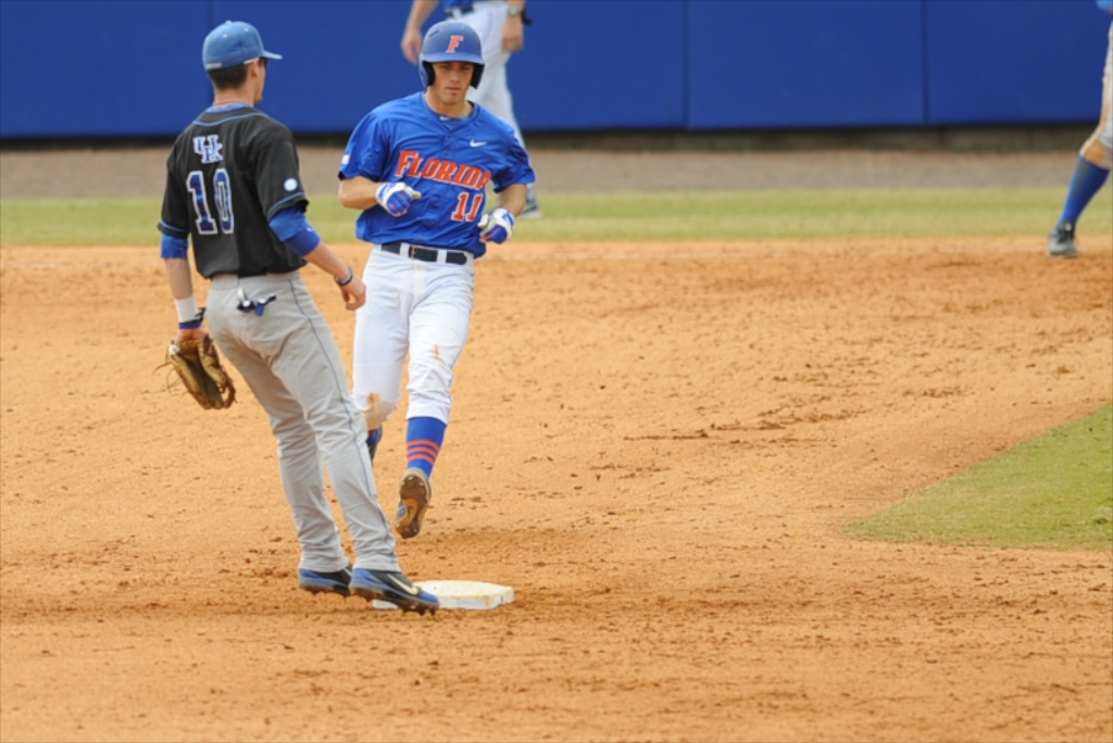 Taylor Gushue (17) makes it to second base in Sunday's game against the Kentucky Wildcats.
