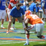 Will Muschamp coaches his players run drills Saturday afternoon at the Orange and Blue Debut.