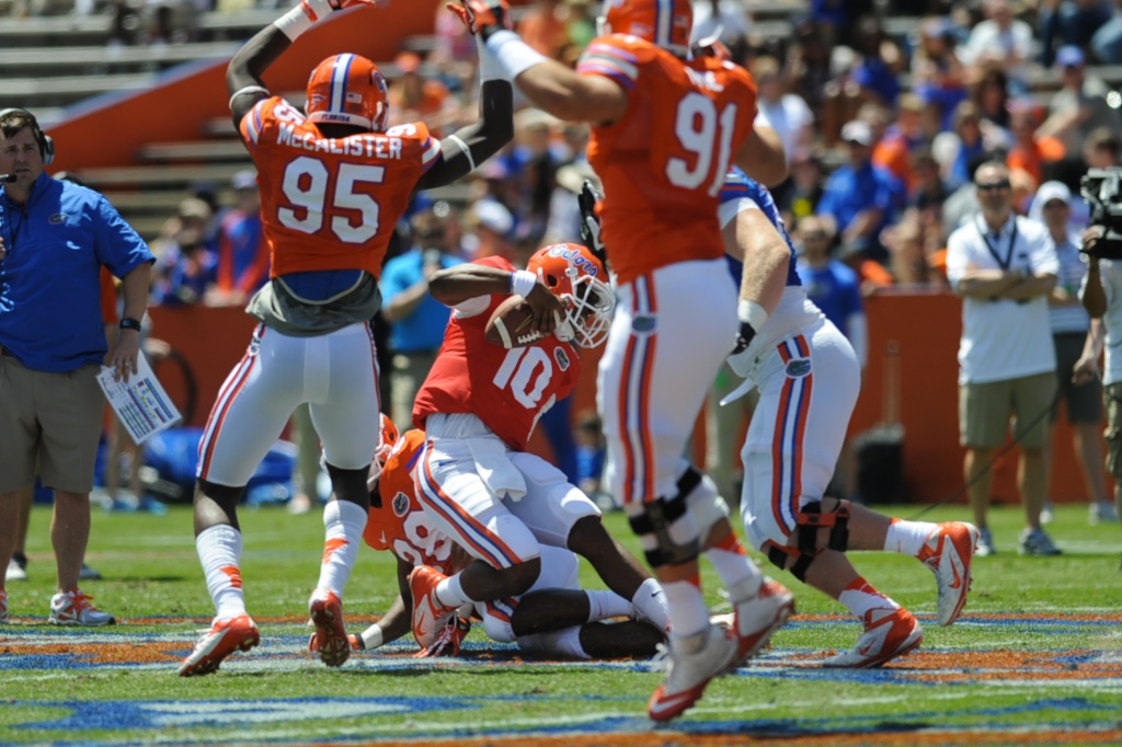 Quarterback Tyler Murphy (10) gets sacked during a scrimmage Saturday afternoon at the Orange and Blue Debut.