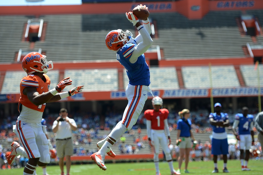 Wide receiver Demarcus Robinson (11) catches the ball for a touchdown during a scrimmage Saturday afternoon at the Orange and Blue Debut.