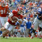 Quarterback Jeff Driskel (6) runs the ball during a scrimmage Saturday afternoon at the Orange and Blue Debut.