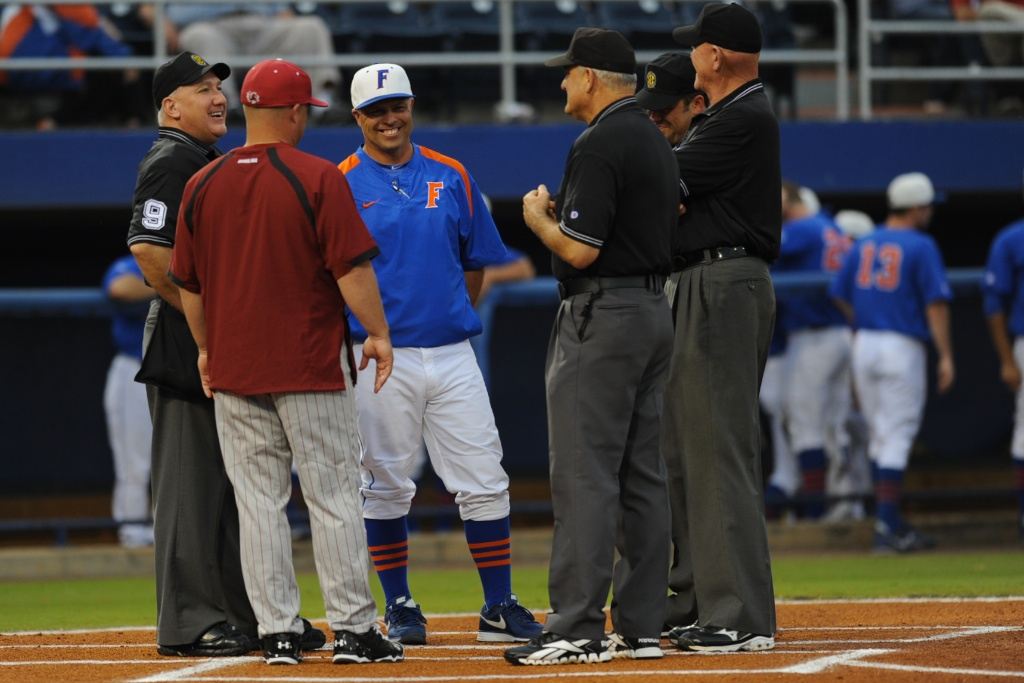 Florida coach, Kevin Sullivan, and South Carolina coach, Chad Holbrook, meet with the umpires prior to Friday's game. Florida defeated South Carolina 4-3 Friday night.