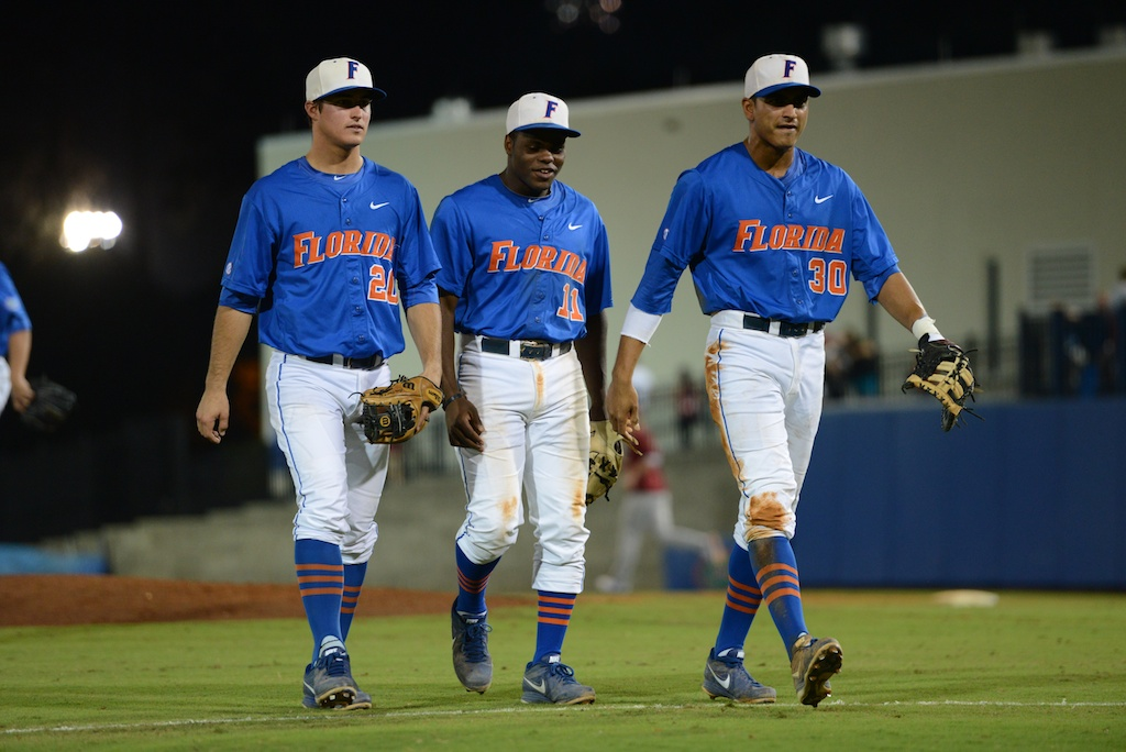 Cody Dent (20), Josh Tobias (11), and Vickash Ramjit (30). Florida defeated South Carolina 4-3 Friday night.