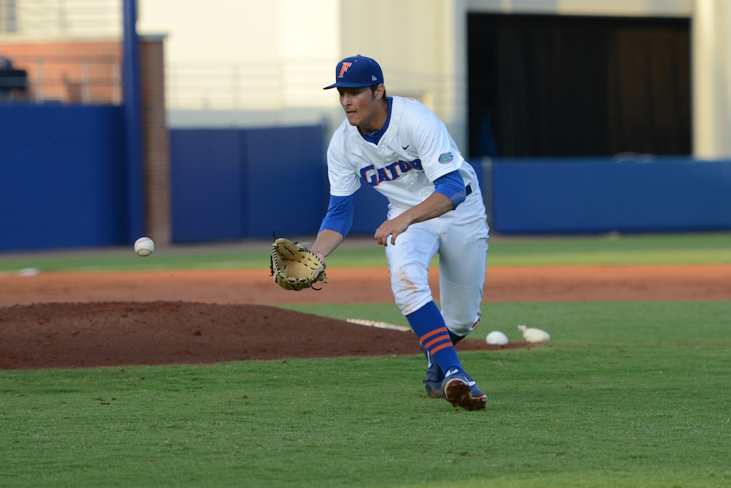 Florida pitcher Danny Young (15) fields a ball to get an out at first base. The Gators defeated the Vols 7-2 Friday night.