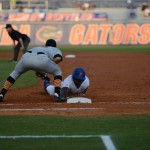 Josh Tobias (11) slides safely back to first base Friday. The Gators defeated the Vols 7-2 Friday night.