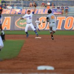 Cody Dent (20) and Vickash Ramjit (30) make a double play early in Friday's game. The Gators defeated the Vols 7-2 Friday night.
