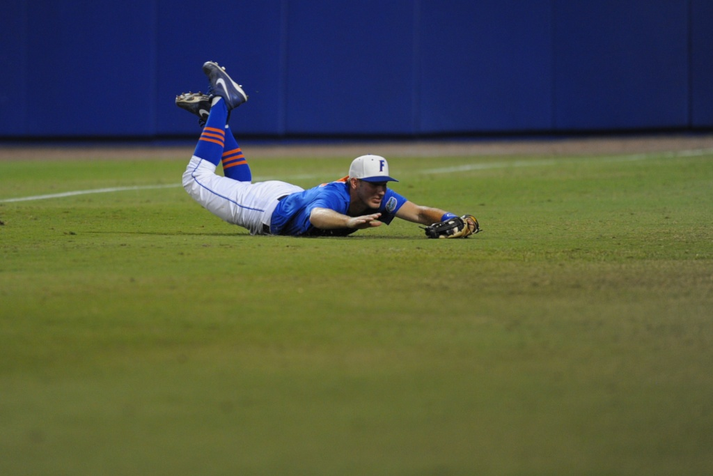 Justin Shafer (16) dives to catch a foul ball for the third out at the bottom of the second inning. Florida defeated South Carolina 4-3 Friday night.