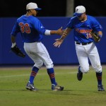 Teammates Vickash Ramjit (30) and Justin Shafer (16) high-five at the bottom of the second inning. Florida defeated South Carolina 4-3 Friday night.