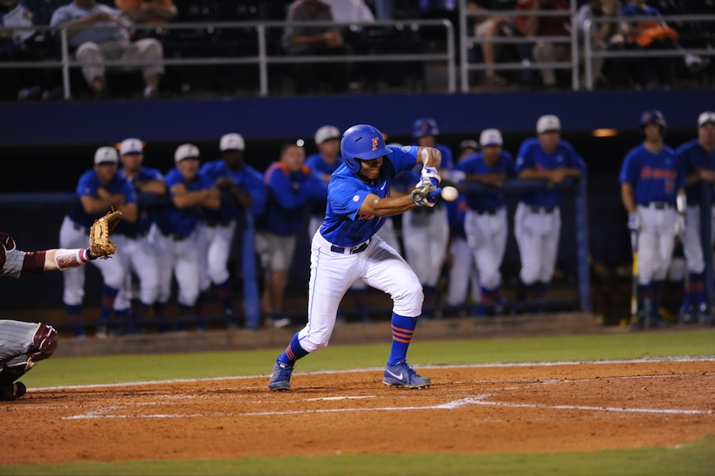 Richie Martin (12) bunts the ball Friday night. Florida defeated South Carolina 4-3 Friday night.