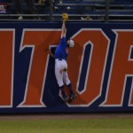 Harrison Bader (8) attempts to catch a homerun hit by South Carolina. Florida defeated South Carolina 4-3 Friday night.