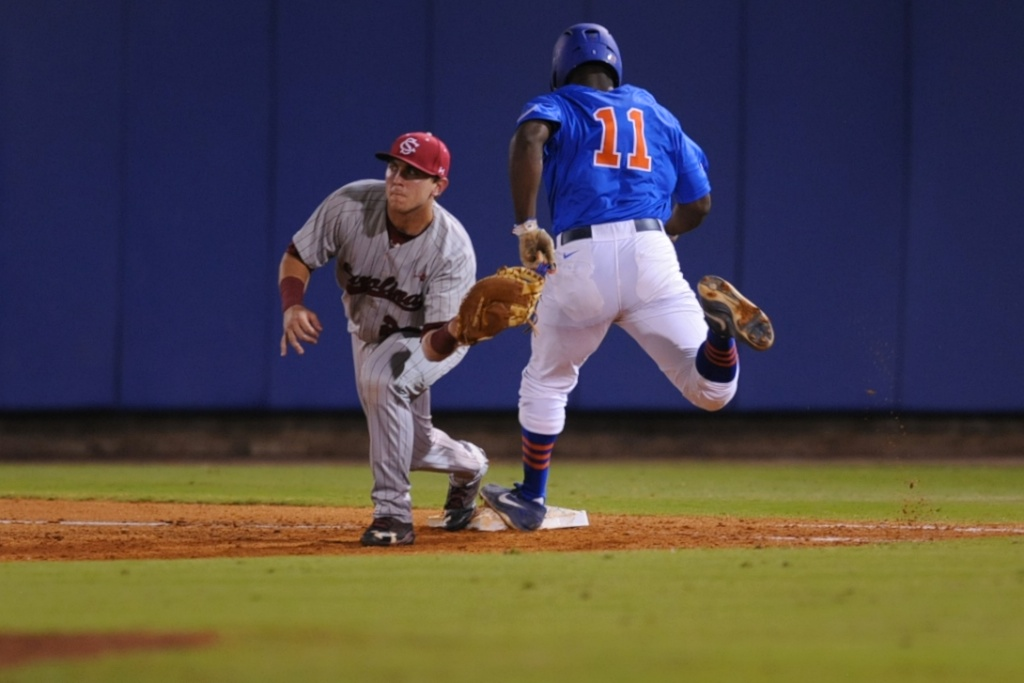 Josh Tobias (11) gets out at first base during friday's game. Florida defeated South Carolina 4-3 Friday night.
