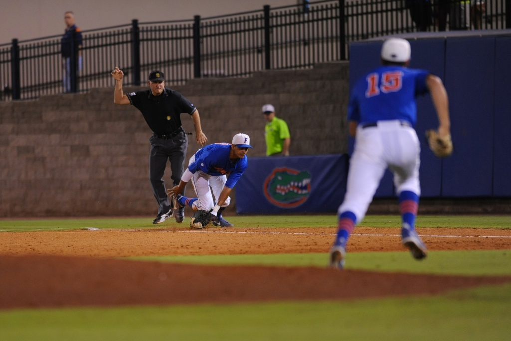 First-baseman Vickash Ramjit (30) stops the ball to get the base runner out at first during Friday's game. Florida defeated South Carolina 4-3 Friday night.