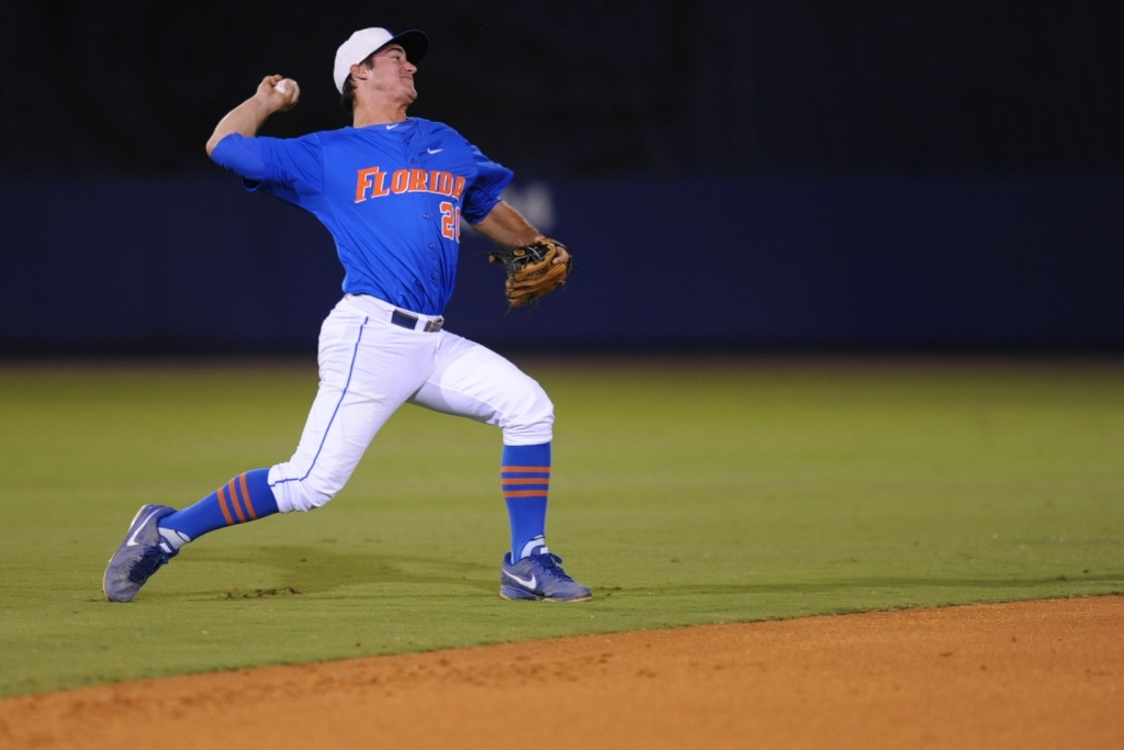 Cody Dent (20) throws to get an out at first base late in Friday's game. Florida defeated South Carolina 4-3 Friday night.