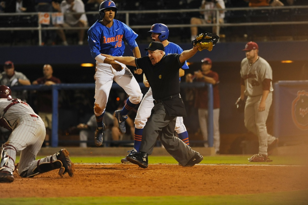 Vickash Ramjit (30) slides into home base for a run for the gators in the bottom of the eighth inning. Florida defeated South Carolina 4-3 Friday night.