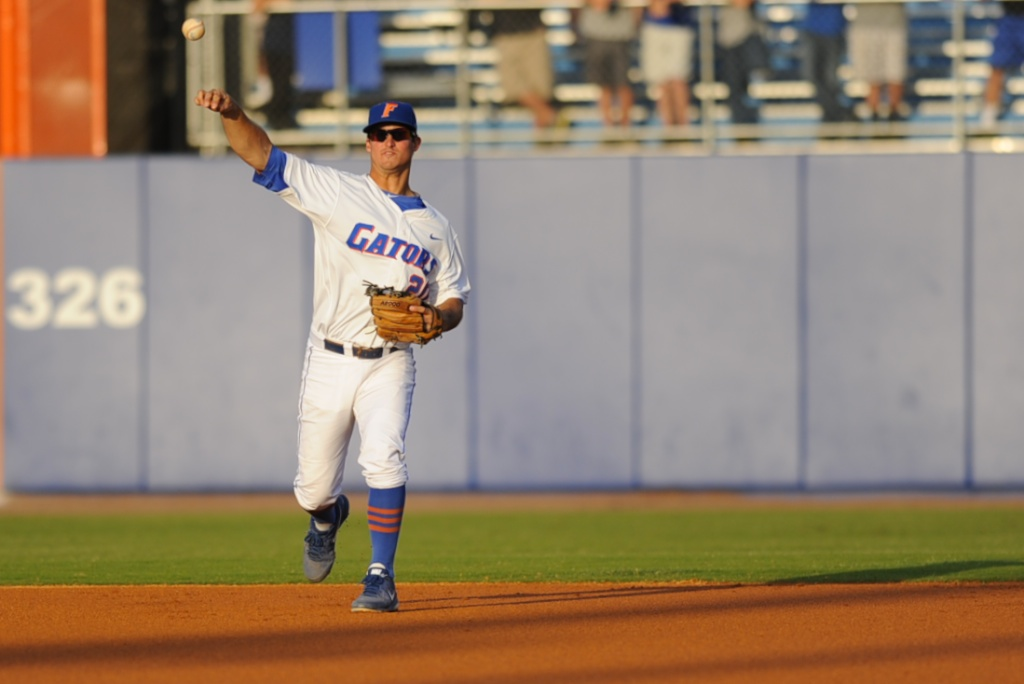 Cody Dent (20) throws the ball to first base during warm ups. The Gators defeated the Vols 7-2 Friday night.