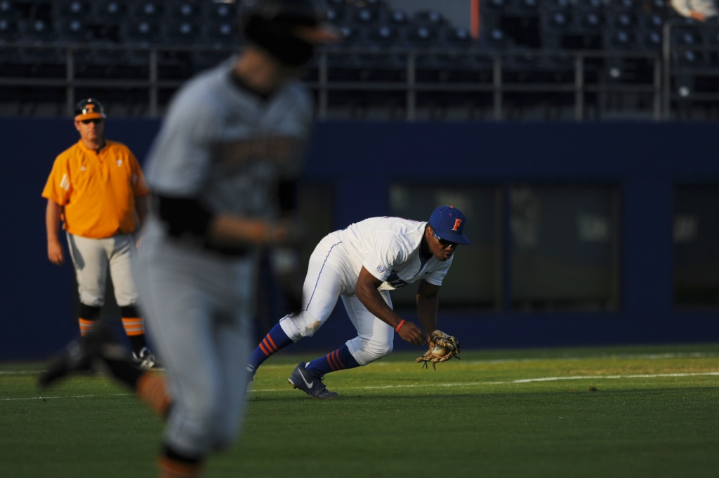 Third-baseman Josh Tobias (11) fields a ball to get an out for the Florida Gators early in Friday's game. The Gators defeated the Vols 7-2 Friday night.