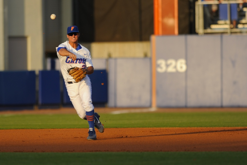 Cody Dent (20) throws the ball to first base for an out during Friday's game. The Gators defeated the Vols 7-2 Friday night.