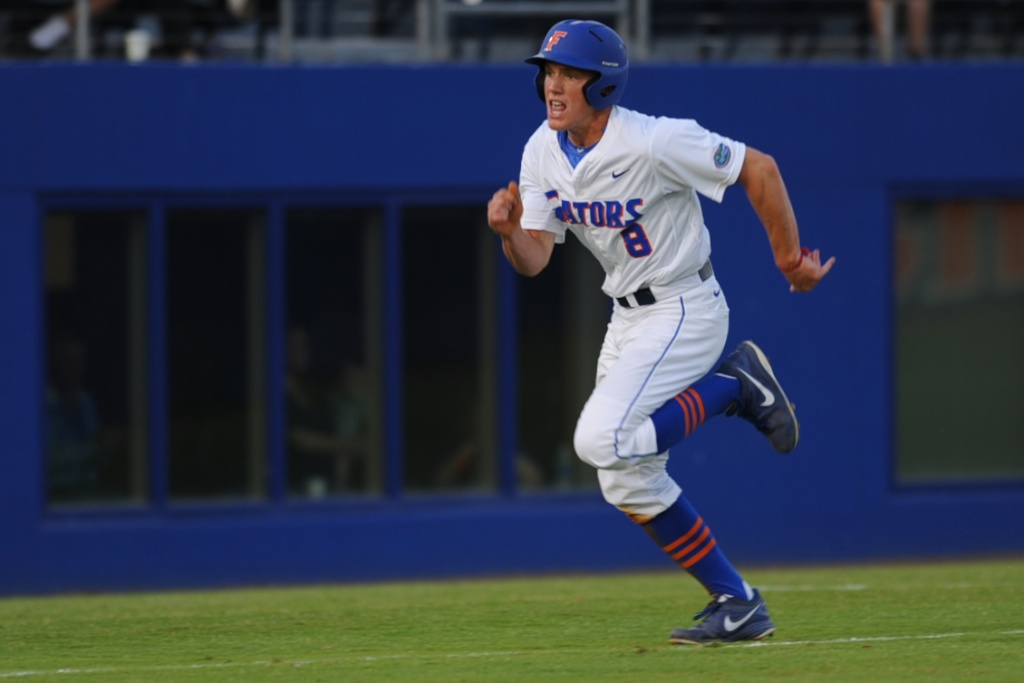 Harrison Bader (8) scores for the Gators early in Friday's game. The Gators defeated the Vols 7-2 Friday night.