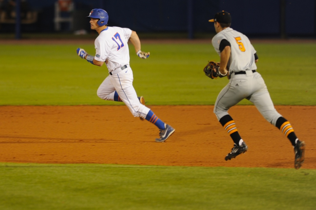 Taylor Gushue (17) makes it to second base in the game against the Tennessee Vols Friday night. The Gators defeated the Vols 7-2 Friday night.