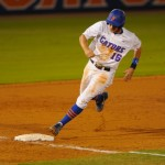 Justin Shafer (16) rounds third base during Friday's game against the Tennessee Vols. The Gators defeated the Vols 7-2 Friday night.