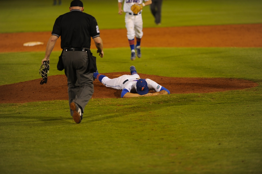 Pitcher Danny Young (15) gets hit by a ball hit by Tennessee batter during Friday's game. The Gators defeated the Vols 7-2 Friday night.